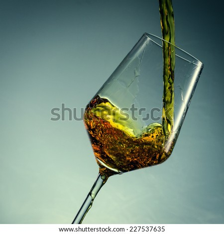close up pouring white wine - stock photo