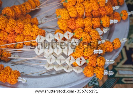Close up : Preparing decorate from flower for rice offering traditional in Laos wedding ceremony, Asia - stock photo