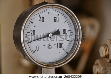 Close up pressure gauge in oil and gas production process. Equipment for measure condition in system.