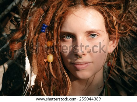Close up Pretty Young Woman Face with Dreadlocks and Piercing Looking at the Camera. - stock photo