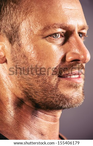 Close-up profile of a handsome mature man. - stock photo