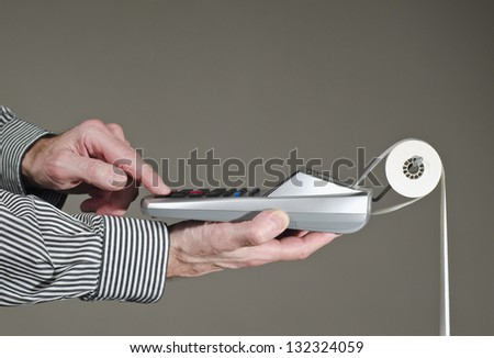 close-up profile of man hands with calculator - stock photo