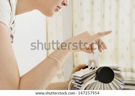 Close profile view young business woman stock photo royalty free close up profile view of a young business woman leaning forward on her office desk and colourmoves