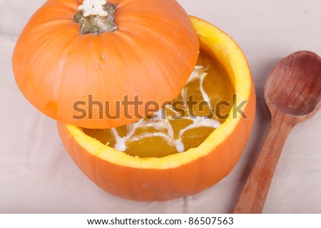 close-up pumpkin soap and wooden spoon.