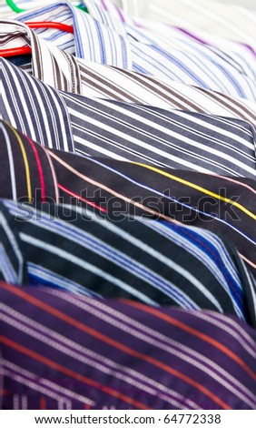 Close-up rack colorful shirts - stock photo