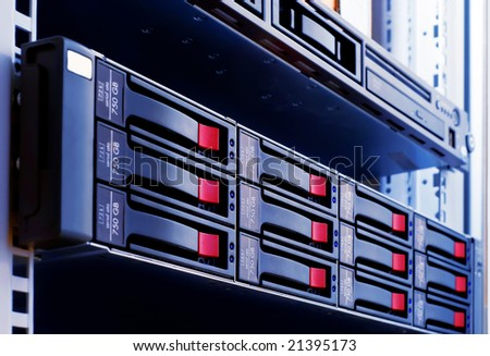 close-up rack-mounted disk array server - stock photo