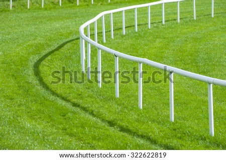close up railing bend of a horse race track - stock photo