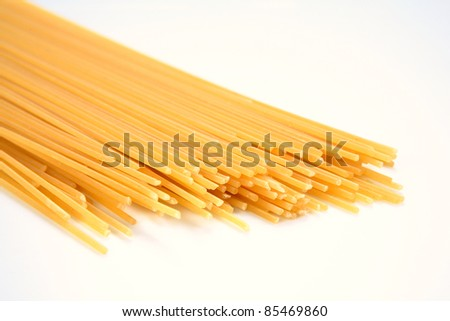 close-up raw pasta isolated on white background