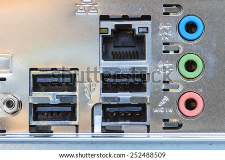 Close up rear panel of computer with audio, usb, ethernet and other connectors - stock photo