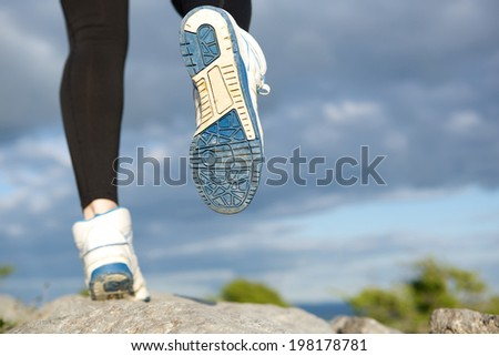 Close up rear view woman running outdoors