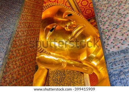 Close up Reclining Buddha gold statue ,Wat Pho, Bangkok, Thailand - stock photo