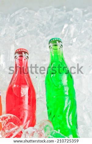 Close up red and green soft drink on ice back ground - stock photo
