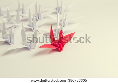 Close up red bird leading among white, Leadership concept, retro filter. - stock photo