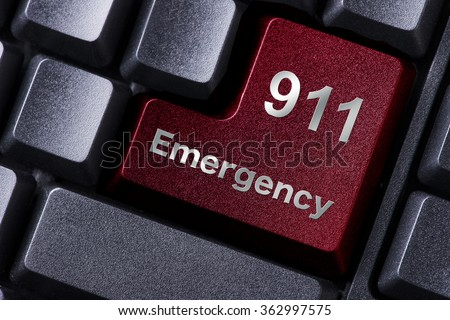close up red enter button written emergency - stock photo