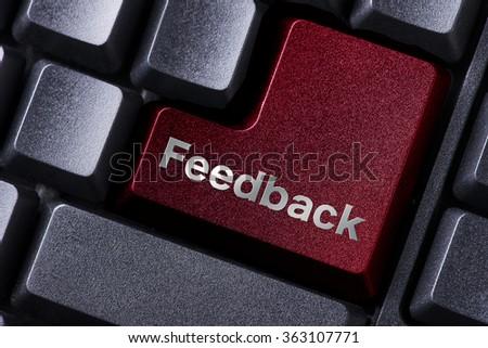 close up red enter button written feedback - stock photo
