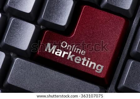 close up red enter button written online marketing - stock photo
