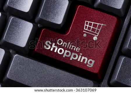 close up red enter button written online shopping - stock photo