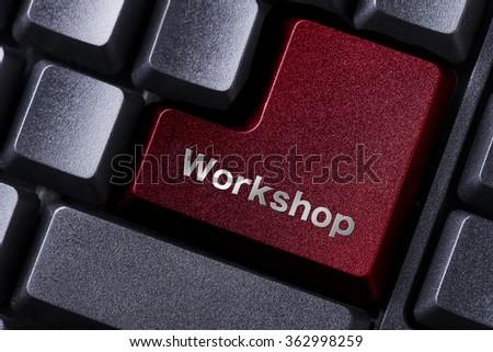 close up red enter button written workshop - stock photo