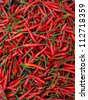 Close up red hot chili peppers on the market - stock photo