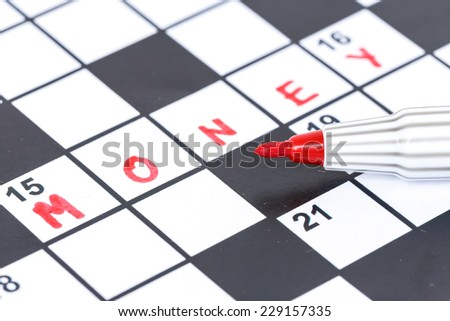 Close up red marker on Crossword - Money - stock photo