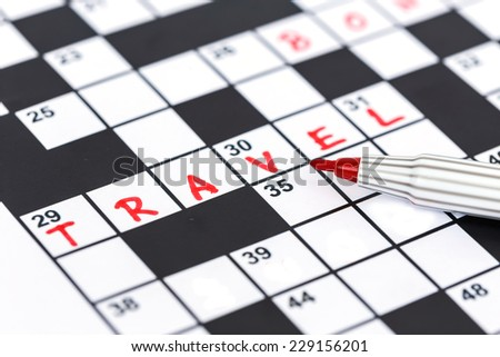 Close up red marker on Crossword - Travel - stock photo
