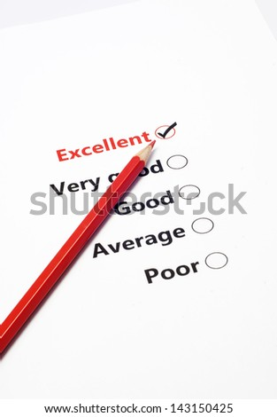 close up red pen point on excellent check list - stock photo