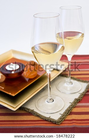 close-up  red & romantic wine dinner setting and candle - stock photo