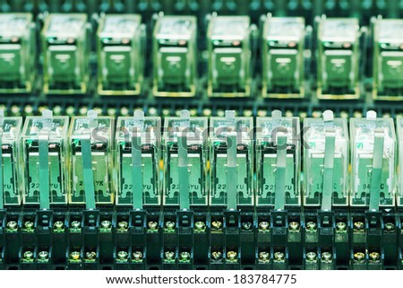 Close up Relay actuators inside the Industrial power case - stock photo