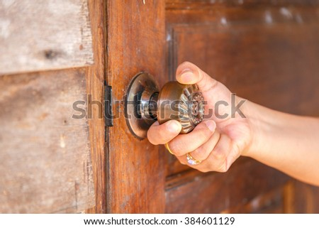 Close up right hand opening the door. - stock photo