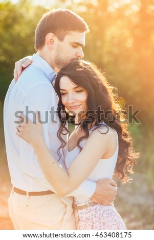 Close up romantic beauty portrait of happy  couple in love hugs and having fun, evening sunlight, hat, emotions, joy, youth, sunny colors, hugs and kisses