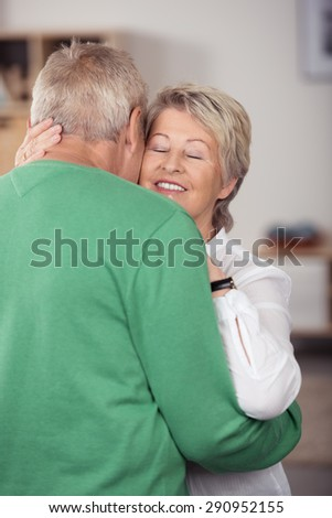 Close up Romantic Middle Aged Couple Embracing One Another While Dancing Sweet Music Inside the House.