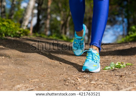 Close Up Runner Female Legs Walking On The Trail In The Park