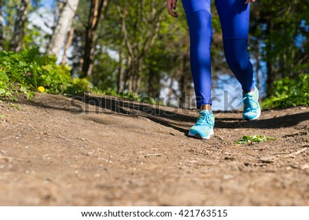 Close Up Runner Woman Legs Walking On The Trail In The Forest