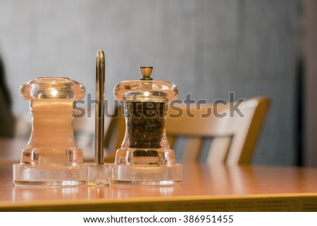Close up salt and pepper on the table in real scence at restaurant