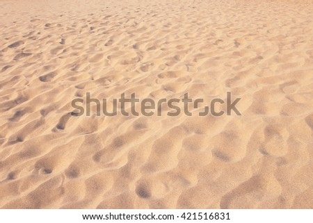 close up sand texture pattern background of a beach in the summer - stock photo