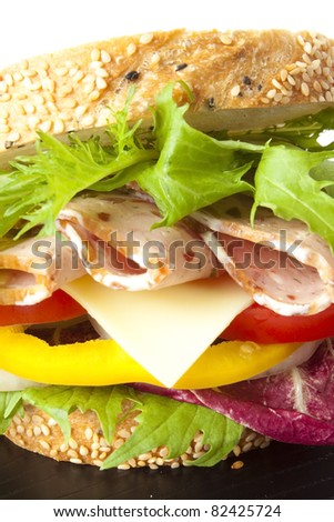 close up sandwich, ham, cheese, veggy and bell pepper sandwich in sesame bread.