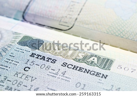 Close up Schengen visa in the passport - stock photo
