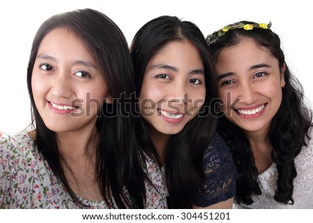 Close up self shot face portrait of three cheerful Asian girls, isolated on white background - stock photo