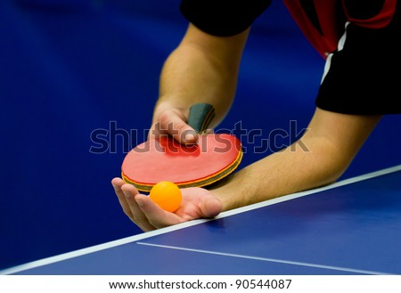 close up service on table tennis - stock photo