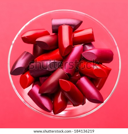 Close-up several different lipsticks in a glass - stock photo