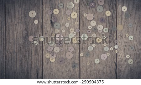 Close up sewing buttons, Colorful buttons on wooden background. - stock photo