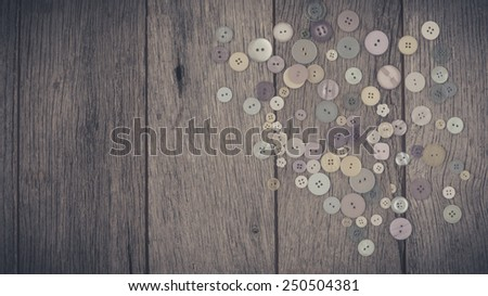 Close up sewing buttons on wooden background. - stock photo