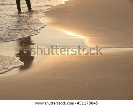 Close up shadow man on the beach