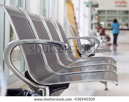 close up shallow depth of field photo of stainless steel chair installed on a balcony terrace public area for customer of a vet animal hospital as functional orientated interior furniture design - stock photo