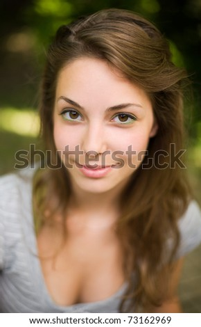 Close up, shallow-dof portrait of a beautiful young brunette. - stock photo