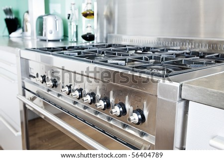 Close Up Shot Across Cooker in Modern Colourful Kitchen - stock photo