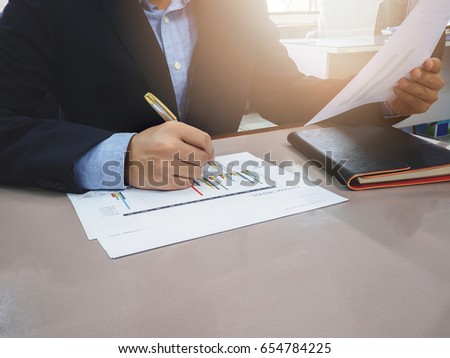 Close up shot businessman writing notes on notebook
