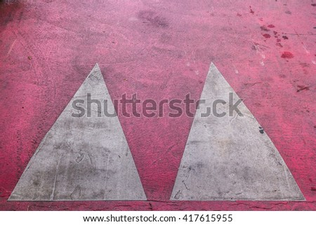 Close up shot from the top to a marked red speed bump - stock photo