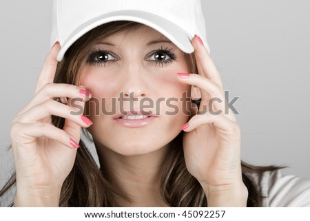 Close Up Shot of a Beautiful Teenager Girl in a White Baseball Cap - stock photo