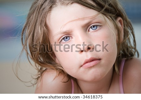 Close Up Shot of a Beautiful Young Child with Wind Swept Hair - stock photo